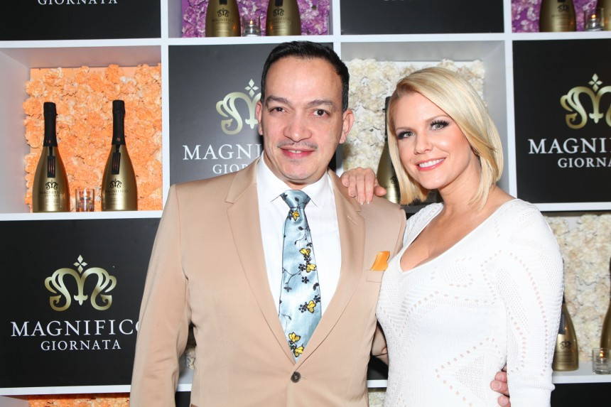 Anthony Rubio with host Carrie Keagan at Magnifico Giornata's Infused Essence Launch Party