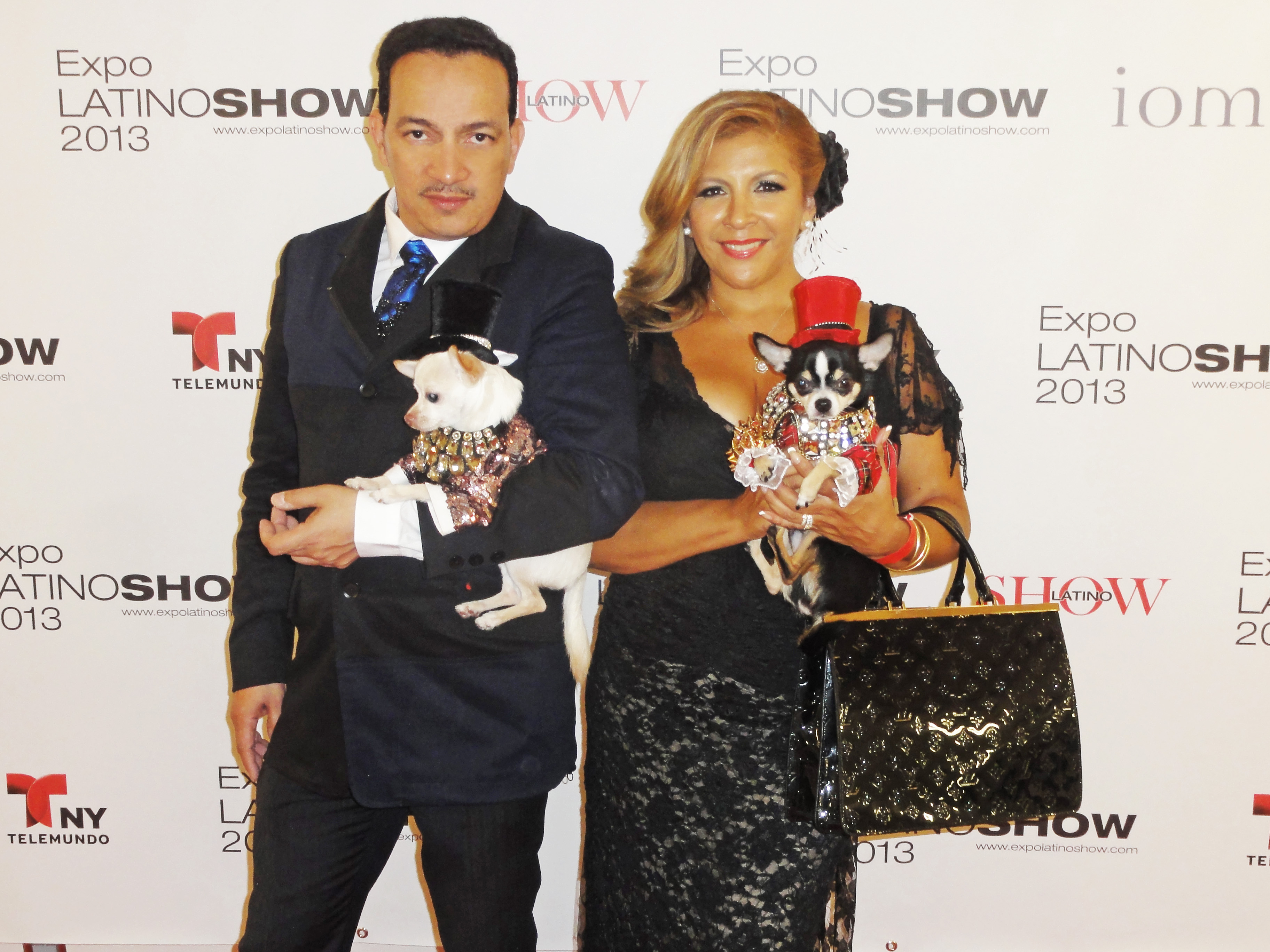 Anthony Rubio holding Kimba with Suica Patricia while holding Bogie