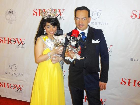 Anthony Rubio holding Bogie and Nency Escamilla holding Kimba