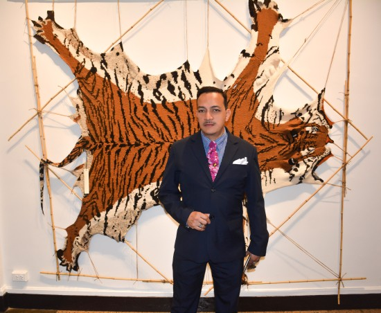 "Anthony Rubio in front of a  knitted Tiger at the  Horticultural Society of New York's ""Auction Art Work"""