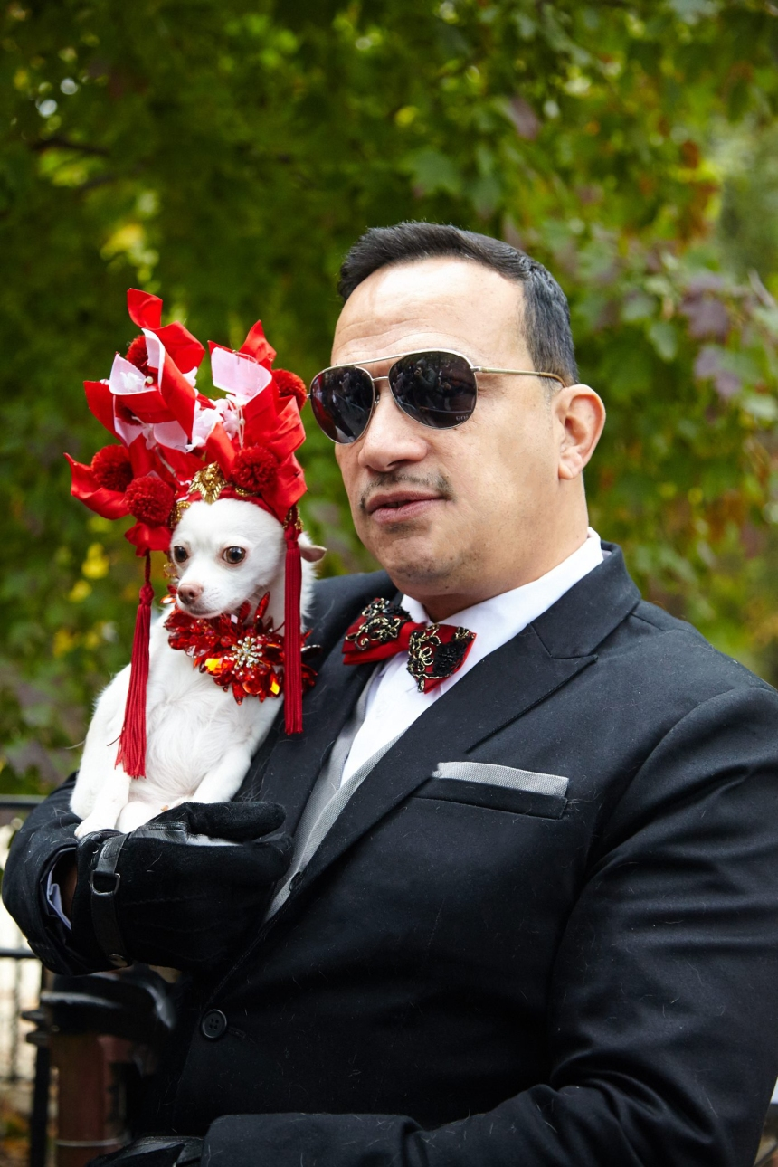 Anthony Rubio with Chihuahua Kimbas as Sarah Jessica Parker at The Met Gala at The 25th Annual Tompkins Square Halloween Dog Parade