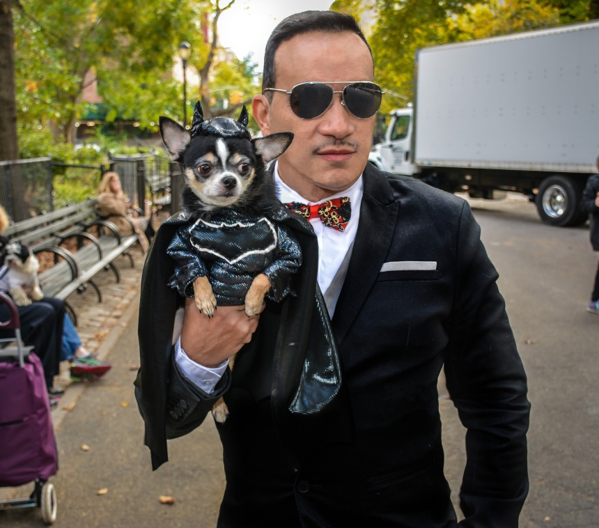 Anthony Rubio with Chihuahua Bogie as Batman at The 25th Annual Tompkins Square Halloween Dog Parade