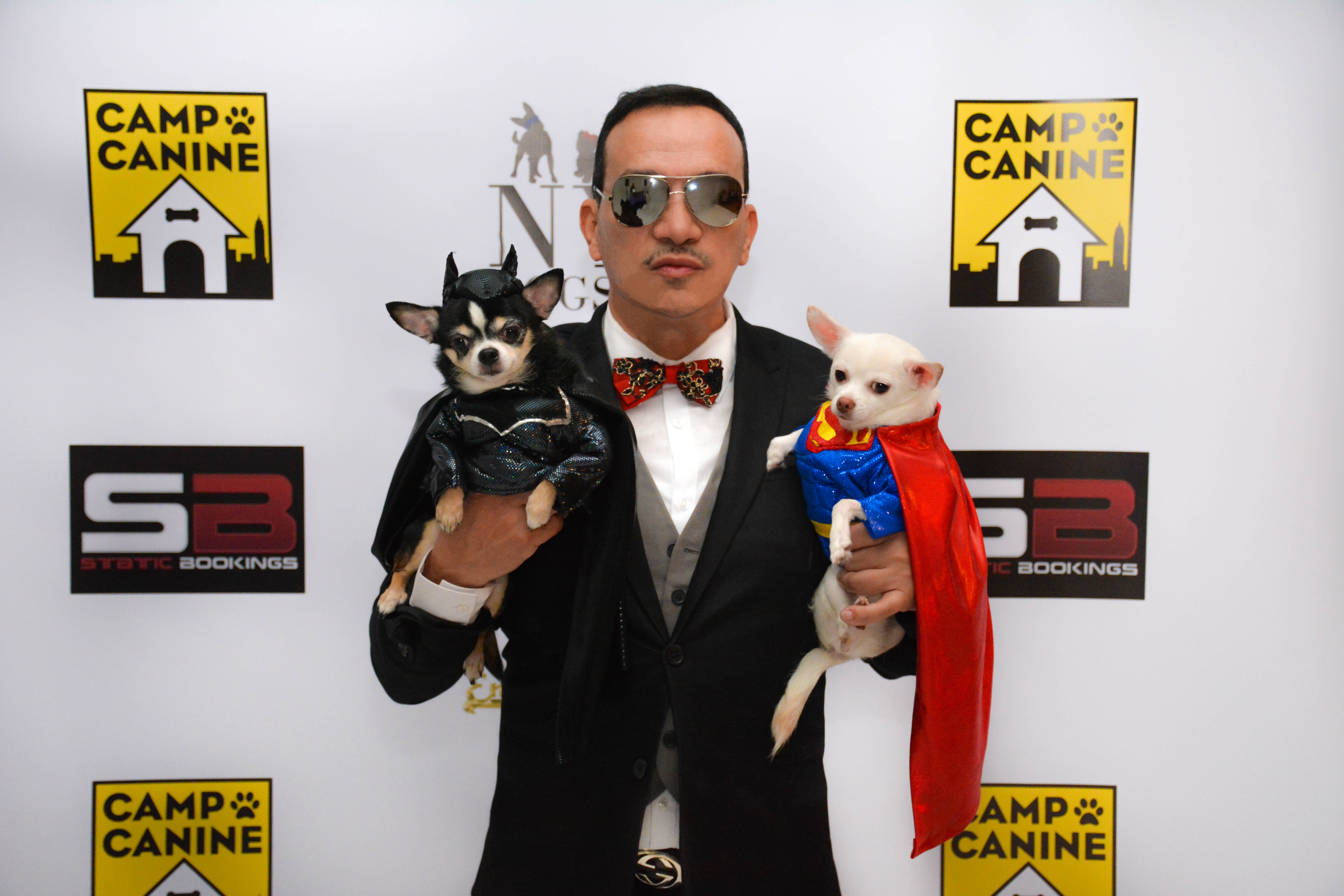 Anthony Rubio with Bogie and Kimba attend Tricks N Treats Halloween Charity Party
