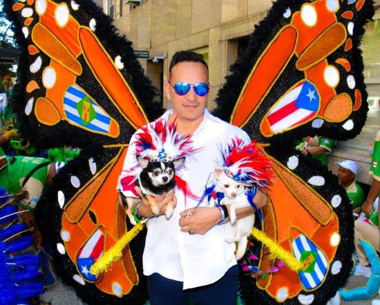 Anthony Rubio with Chihuahuas Bogie and Kimba at the National Puerto Rican Day Parade in New York
